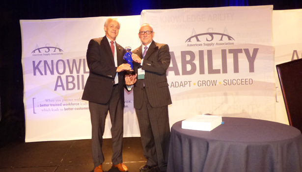 First Supply's Joe Poehling is presented the ASA Plumbing Division's Award of Excellence .