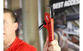 Senior Product Manager Brian Doyle shows off the newest adjustable pipe wrenches available from Milwaukee Tool during the New Product Symposium May 2 in Milwaukee.