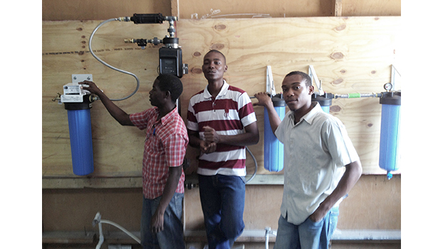 Plumbers Without Borders (PWB) worked with students at Haiti Tec