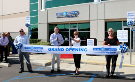 Cutting the ribbon at the official Jones Stephensâ?? West Coast grand opening.
