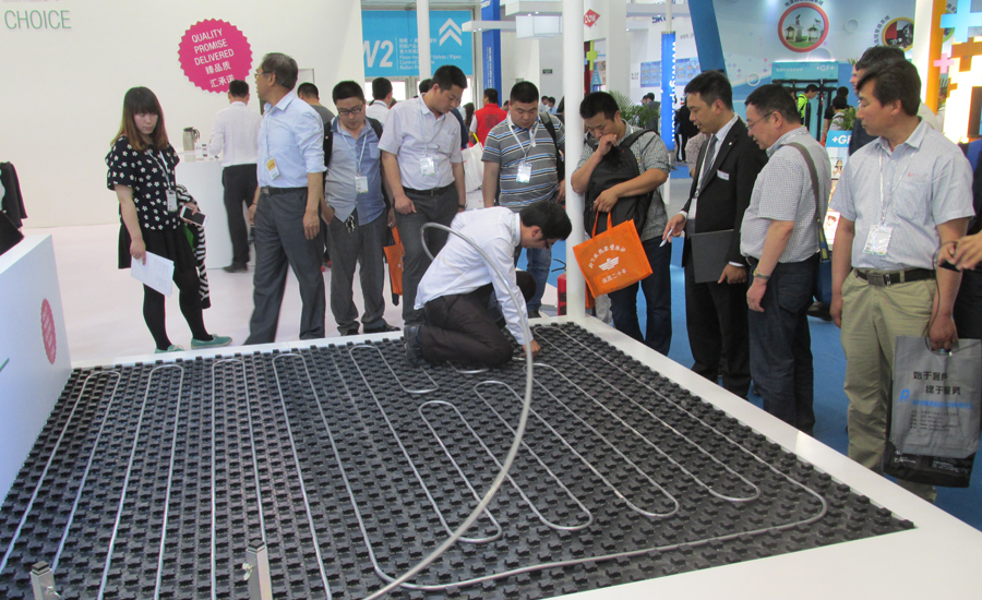 Visitors of REHAU�¢??s booth Wednesday at the 2015 ISH China trade show