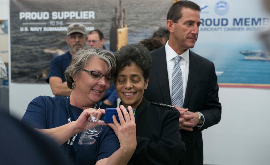 Adm. Michelle Howard, vice chief of Naval Operations, takes a photo with an employee during a tour of the Milwaukee Valve manufacturing plant.
