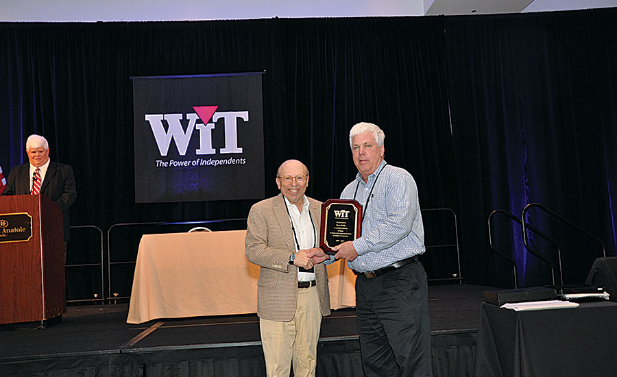 WIT & Co. President Bruce Tucker (left) honors Goodin Co.'s Steve Kelly