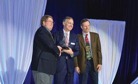 KBIS: Moen President David Lingafelter (center) accepts the Crystal Vision Partnership Award