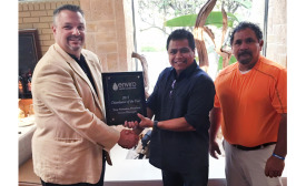 Accepting the award for Winsupply is Tony Victorino, Tucson Winsupply President.