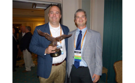 Pepco Sales Charlie Parham presents AIM/R's prestigious Eagle Award to Uponor Vice President of Sales Brent Noonan at NETWORK2016
