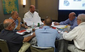 WANE members collaborate on a project during a breakout session