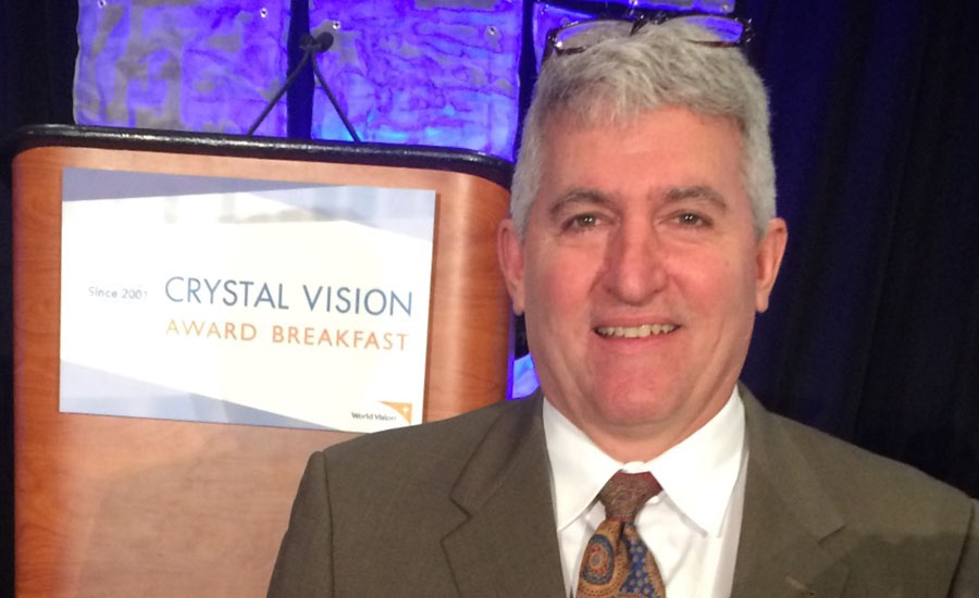 Mansfield Plumbing Products President Jim Morando attends the Crystal Vision Award Breakfast .