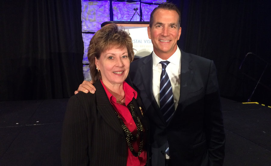 PMI CEO Barbara Higgens stands with Kohler Co. President and CEO David Kohler.