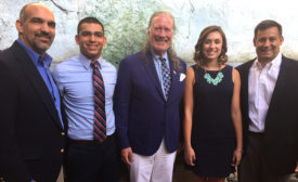 John Hazen White, Jr. poses with Taco Student Scholarship Award recipients