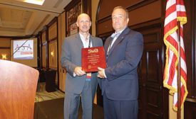 SWA Chairman of the Board John Simmons (Winsupply-Noland Co., left) honors SWA President David Popek (VAMAC)