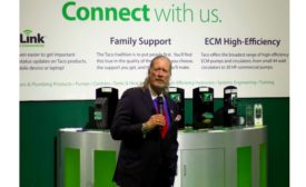 Taco Comfort Solutions President and CEO John Hazen White Jr. speaks to AHR Expo media Monday morning at the company's booth
