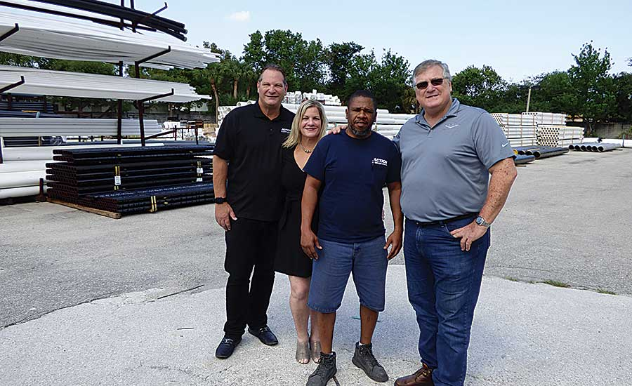 Ken Berke, Sadler, Lake Worth Warehouse Manager Milton Williams and Stuart Berke.